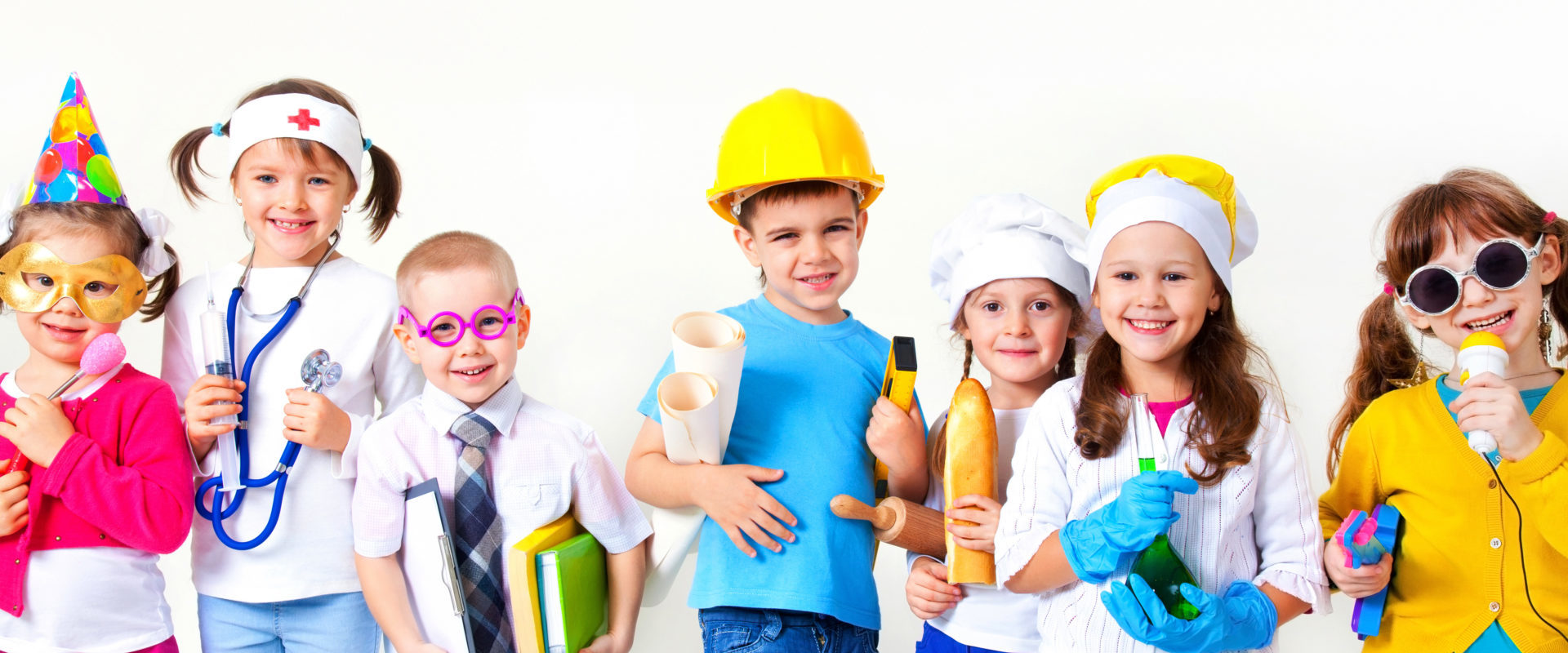 Group of seven children dressing up as professions